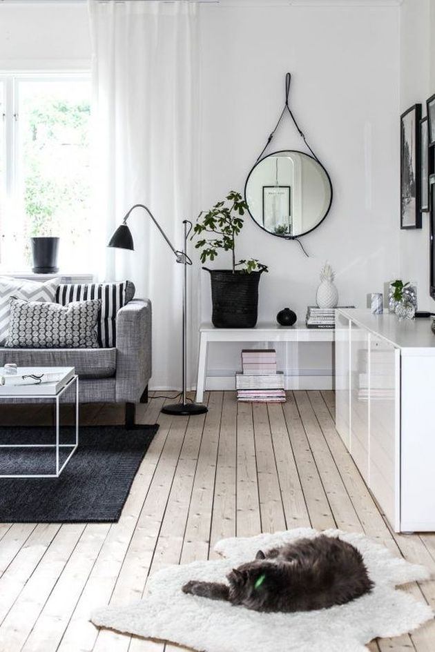 Black and White Living Room Design with Wall Mirror