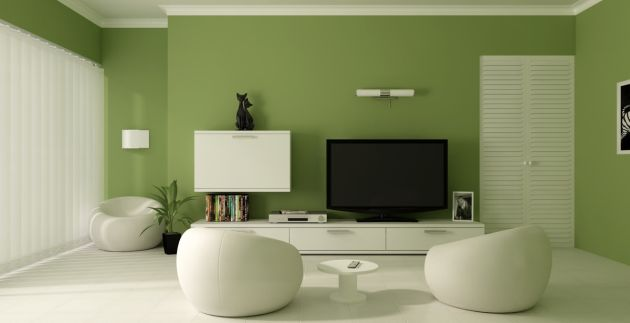 Green Living Room Design Idea with A White Entertainment Console and Accent Chairs