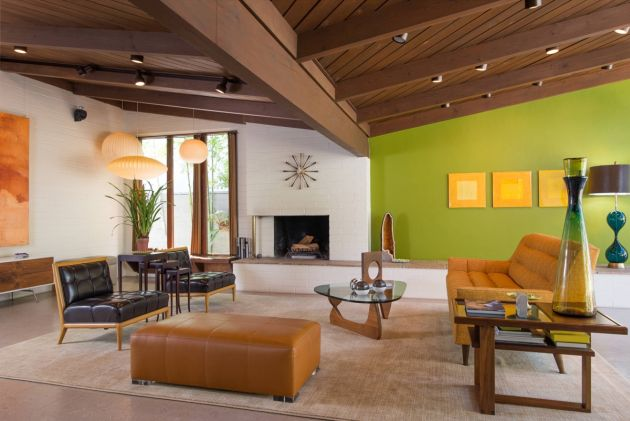 Green Living Room Design Idea with Dark Leather Accent Chairs and Large Ottoman