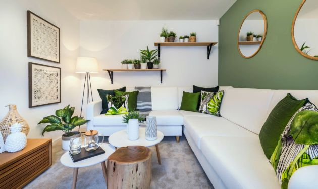 Green Living Room Design Idea with Plants on The Wall Shelves