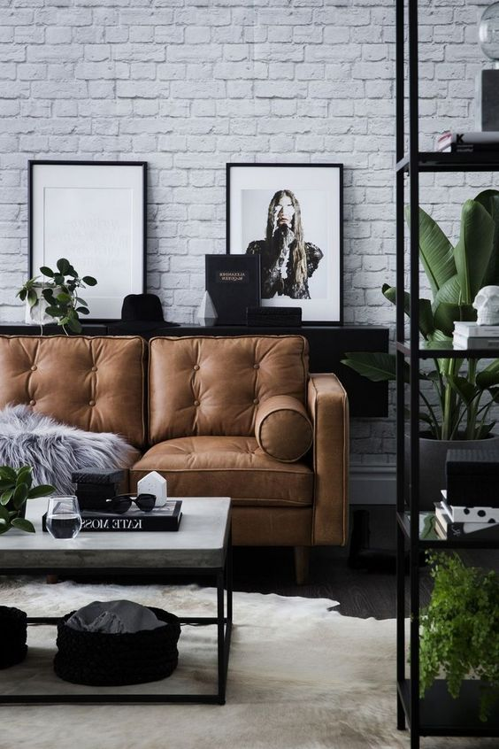 Scandinavian Living Room In Black And White With White Brick Wall