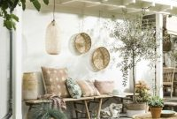 Welcoming Boho Tropical Patio With A Rattan Table