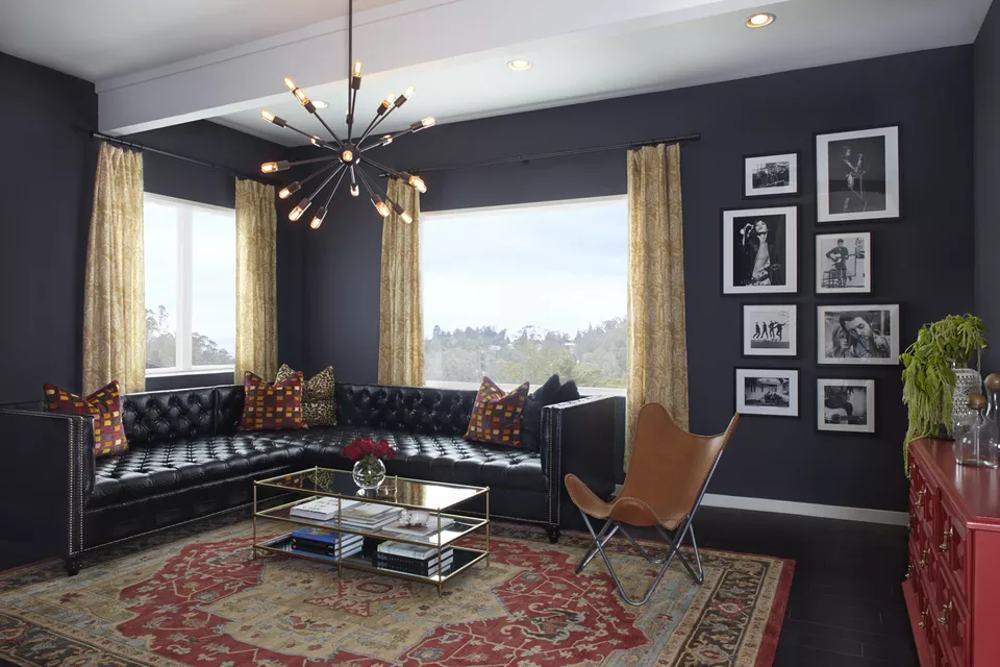 black living room with sectional sofa