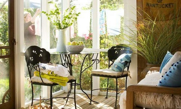 Eclectic Sunroom Space With Forged Chairs