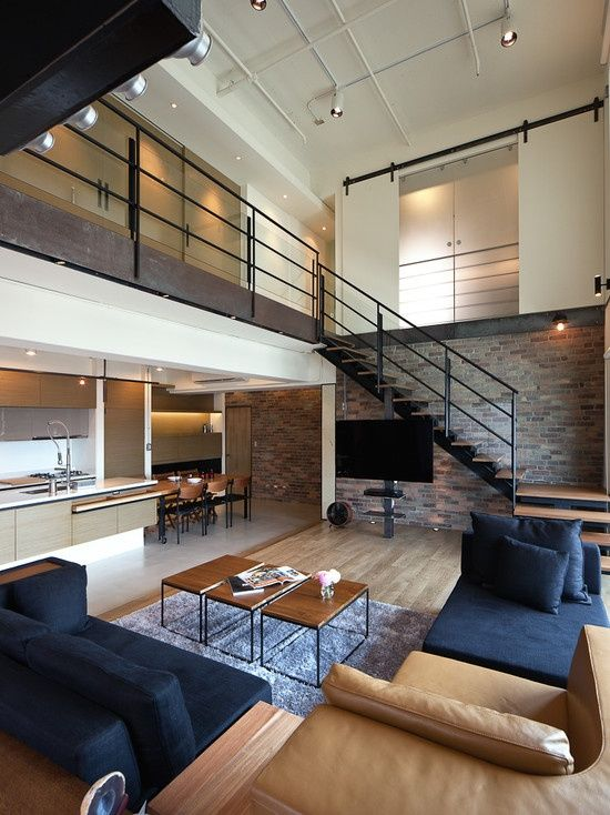 Living Room With Brick Statement Wall In Muted Shades