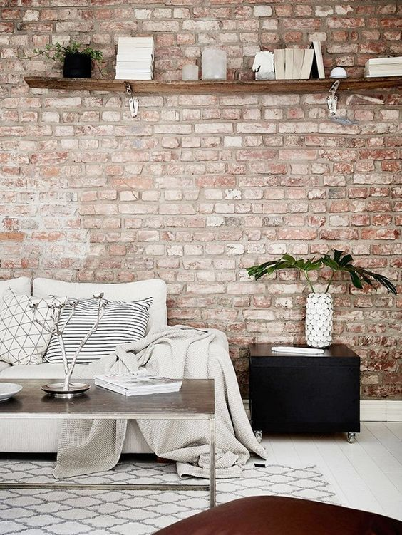 Living Room With Muted Red Brick Wall And Neutral Furniture