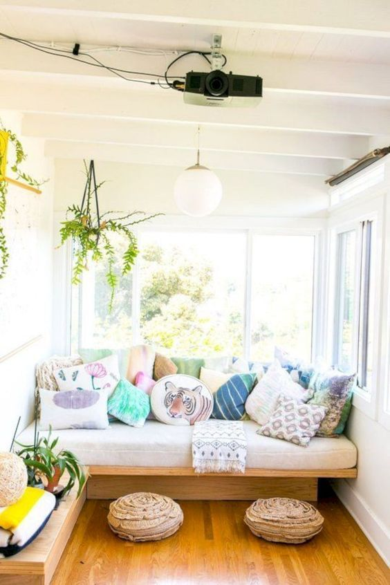 Sunroom With Sofa And Pillows