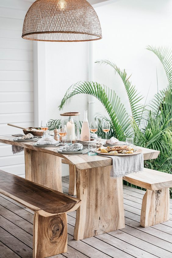 Tropical Outdoor Dining Space With Rough Wooden Furniture