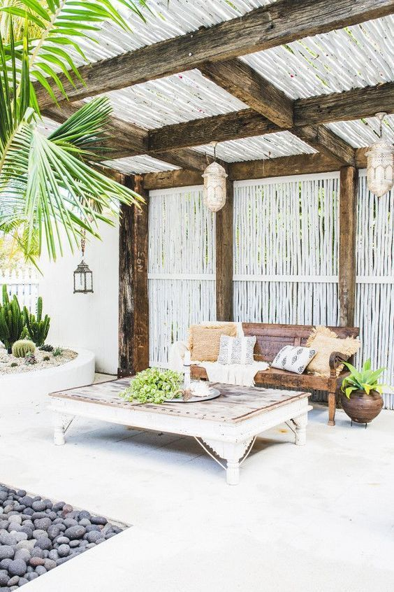 Tropical Patio With Woven Lanterns And Wooden Beach