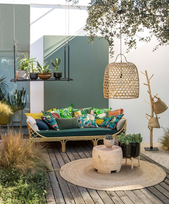 Tropical Terrace With A Rattan Sofa And Colorful Pillows