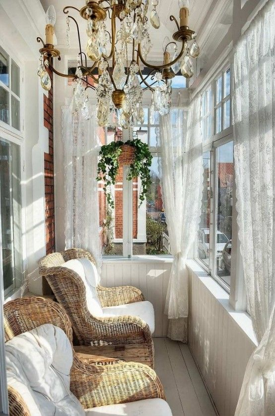 Vintage-Inspired Sunroom With A Large Crystal Chandelier