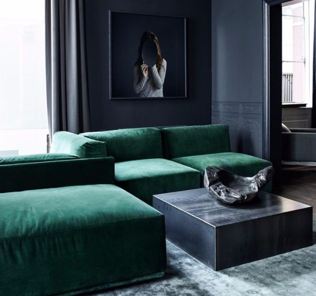 A Monolithic Center Table Design In A Black And Green Room