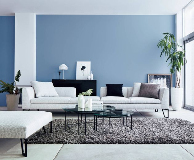 Blue Living Room With Indoor Plants And Nesting Coffee Tables