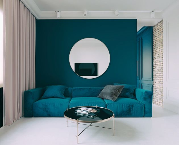 Blue Living Room With Round Mirror And Round Coffee Table