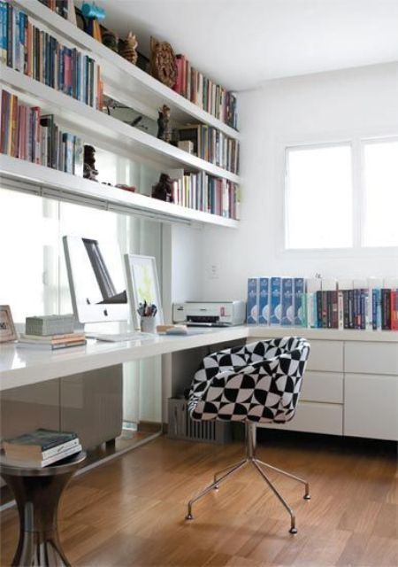 Home Office With White Shelves Over The Desk
