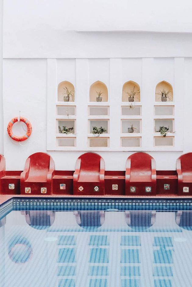 Indoor Swimming Pool Design Built-In Seating Painted In A Bright And Cheerful Hue
