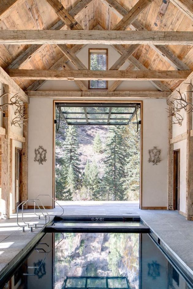 Indoor Swimming Pool Design With Antler Wall Décor
