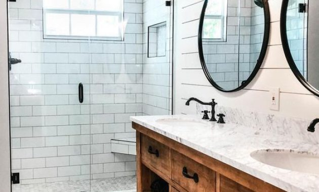 Modern Farmhouse Bathroom With A Stained Vanity And Hex Tiles