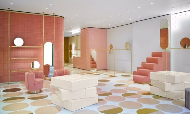 Pink Living Room Design By India Mahdavi With A Sleek Block-Like Center Table