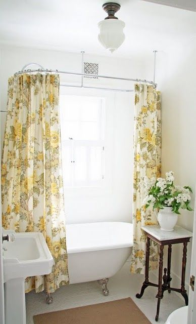 Small Farmhouse Bathroom With Yellow Printed Curtains