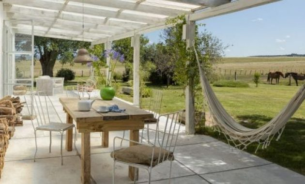 Small Patio Decor Ideas With Iron Chairs And Hammock