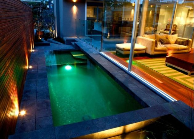 Small Swimming Pool with Colorful Tiles and Tropical Plants
