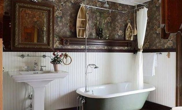 Vintage Farmhouse Bathroom With A Wooden Floor And White Beadboard