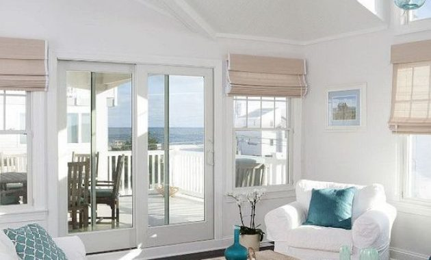 Airy Beach Living Room With Woven Roman Shades