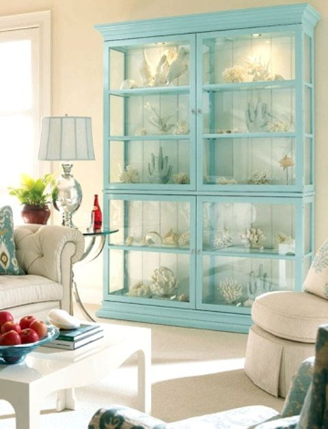 Aqua Blue Armoire With Various Corals On Display