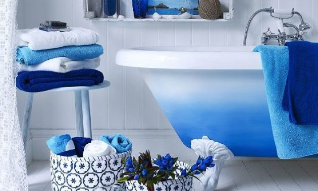 Bathroom With Fabric Baskets And A Bright Ombre Blue Clawfoot Bathtub