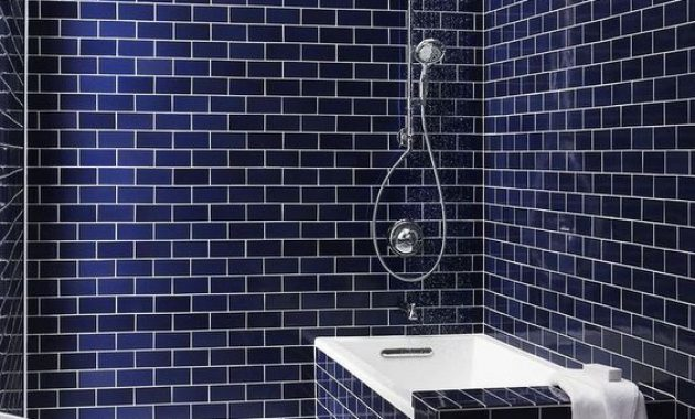 Bathroom With Navy Subway Tiles With White Grout And A Bathtub Clad