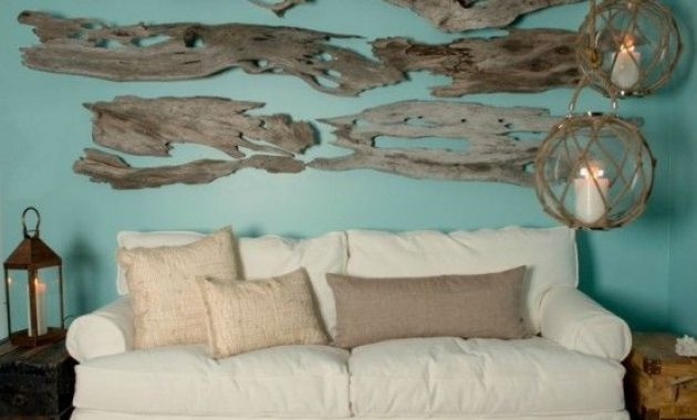 Beachy Living Room With A Turquoise Wall With Driftwood