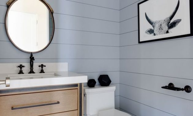 Beautiful Contemporary Light Blue Bathroom With A Wooden Vanity And Hex Tiles