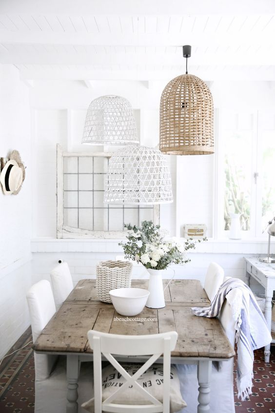 Beautiful Dining Space With Several Painted And Non-Painted Wicker Lampshades