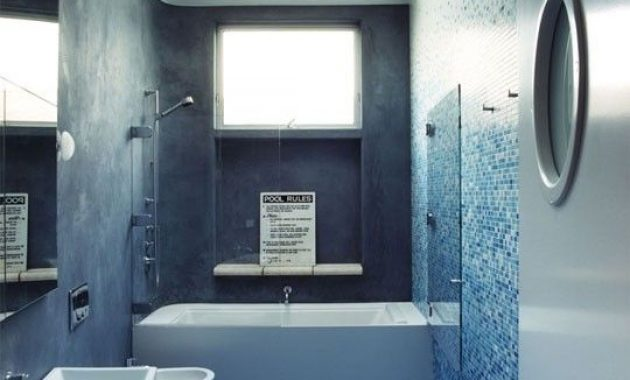 Blue Bathroom With Grey Concrete Paired With Mosaic Tiles