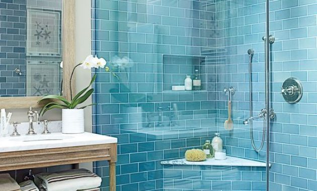 Blue Bathroom With Grey Marbled Tile Floor And A Vintage Wooden Vanity