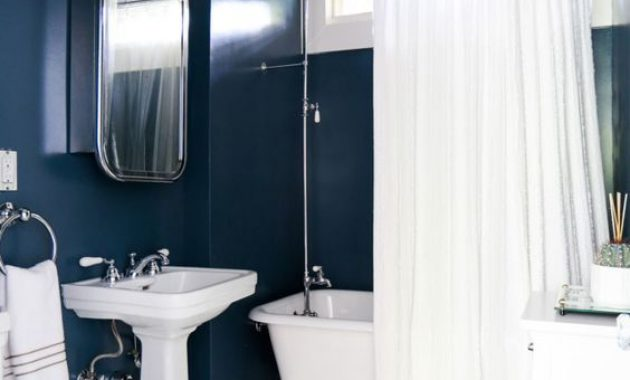 Blue Bathroom With Navy Painted Walls Paired With All The Rest In Creamy Shades