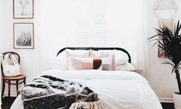 Boho Bedroom With A Large Wicker Lampshade