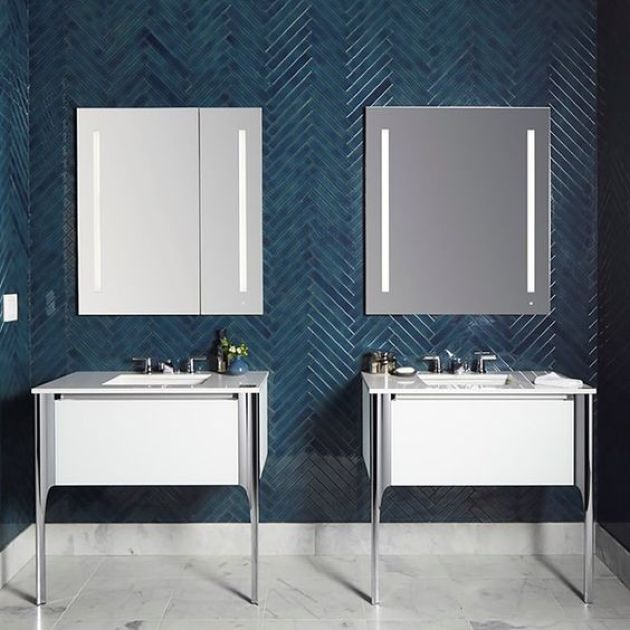 Bold Contemporary Bathroom With Teal Skinny Tiles Clad In A Chevron Pattern