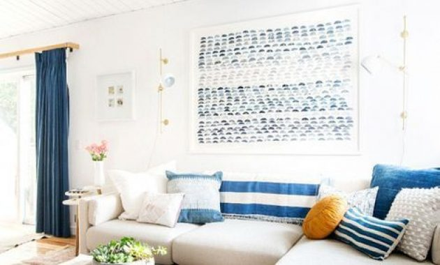 Bright Coastal Living Room With Striped Pillows