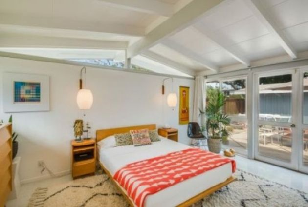 Bright Mid-Century Modern Bedroom With A Warm Colored Bed And Nightstands