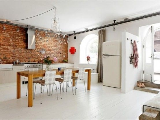 Bright White Kitchen Spruced Up With A Red Brick Wall
