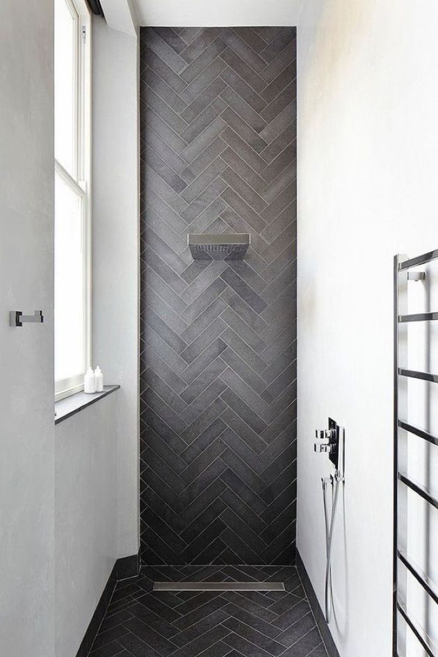 Chic Contemporary Shower Space With White Walls And An Accent Graphite Grey Skinny Tiles Clad