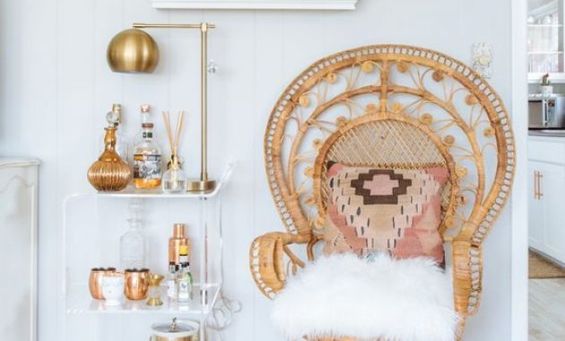 Chic Drink Space With A Peacock Chair With A Bright Pillow