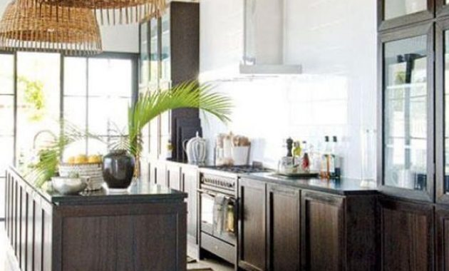Chic Tropical Kitchen With Dark Stained Cabinets