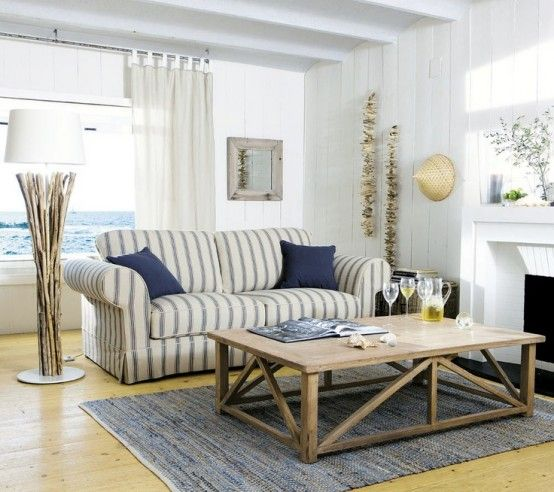 Coastal Living Room With A View And A Striped Sofa