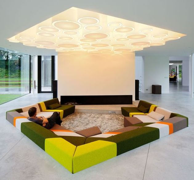 Colorful Contemporary Conversation Pit With A Geometric Lit Up Ceiling