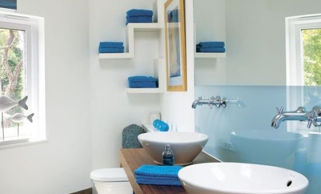 Contemporary Bathroom With Sleek Light Blue Half Wall And Bright Blue Towels