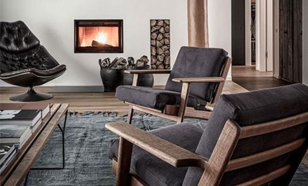 Contemporary Masculine Living Room With Dark Furniture And A Built-In Fireplace
