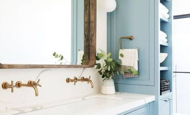 Cozy Rustic Bathroom With Light Blue Furniture
